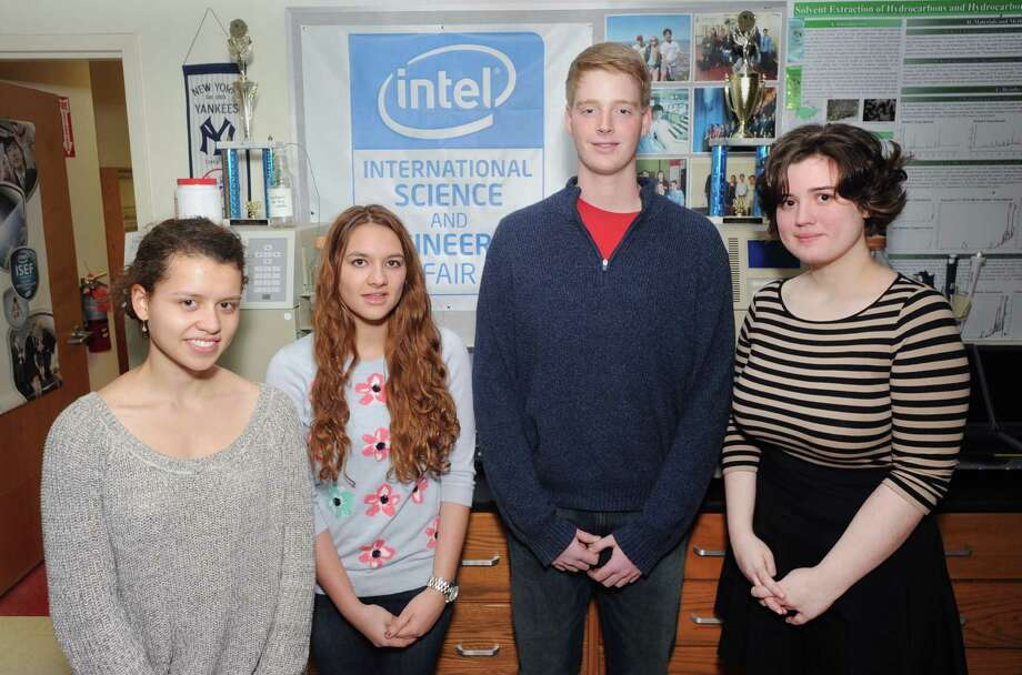 Four Greenwich High School seniors have been named semifinalists in the 2014 Intel Science Talent Search, they are from left, Friederike Buck, 17, Zheni Gusho, 17, Travis Anderson, 18, and Anne Merrill, 17, at Greenwich High School, Wednesday, Jan. 15, 2014. Photo: Bob Luckey / Greenwich Time