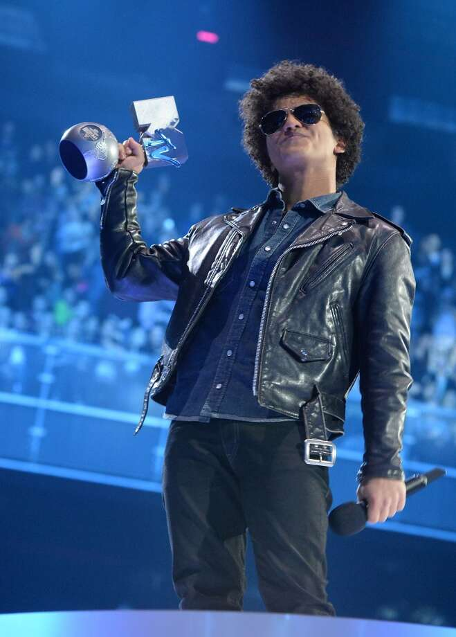 AMSTERDAM, NETHERLANDS - NOVEMBER 10:  Bruno Mars accepts the Best Song award onstage during the MTV EMA's 2013 at the Ziggo Dome on November 10, 2013 in Amsterdam, Netherlands.  (Photo by Jeff Kravitz/FilmMagic) Photo: FilmMagic