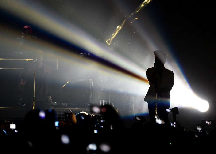 LAS VEGAS, NV - DECEMBER 31:  Recording artist Bruno Mars is silhouetted as he performs during a New Year's Eve concert inside The Chelsea at The Cosmopolitan of Las Vegas on December 31, 2013 in Las Vegas, Nevada.  (Photo by Ethan Miller/WireImage) Photo: WireImage