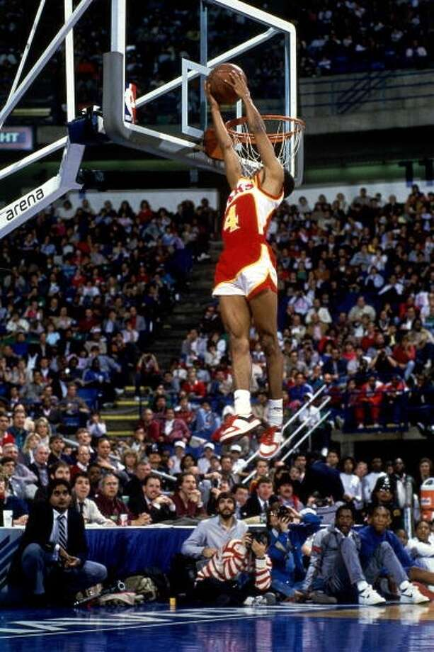 1986: Spud Webb   Location: Dallas Team: Atlanta Hawks Photo: Andrew D. Bernstein, NBAE/Getty Images