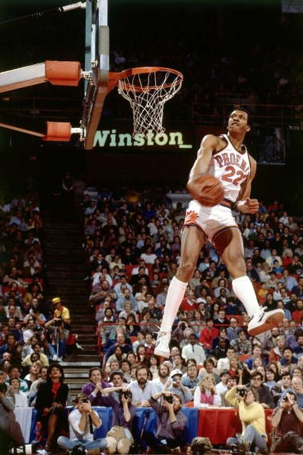 1984: Larry Nance   Location: Denver Team: Phoenix Suns Photo: Andrew D. Bernstein, NBAE/Getty Images