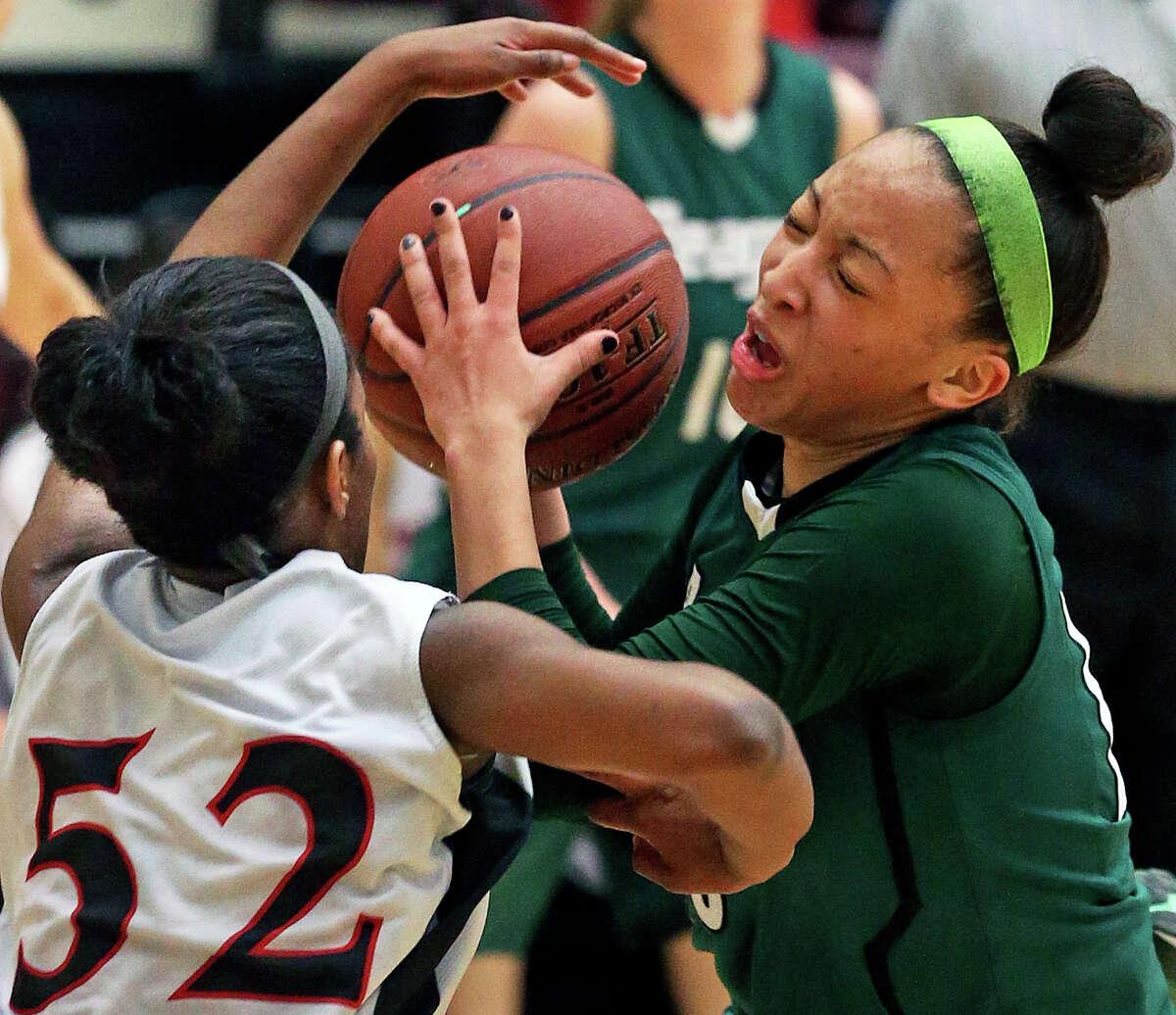 Rattler guard Mailee Jones battles Julia Wilson under the basket as Reagan plays Churchill in girls basketball at Littleton Gym on January 14, 2014.