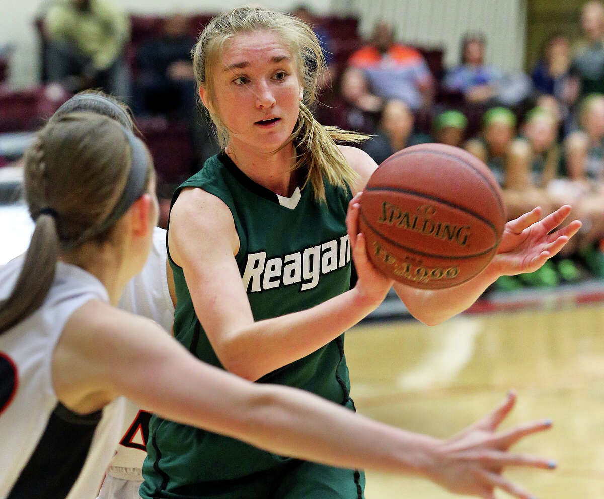 Wendy Knight passes in the lane for the Rattlers as Reagan plays Churchill in girls basketball at Littleton Gym on January 14, 2014.