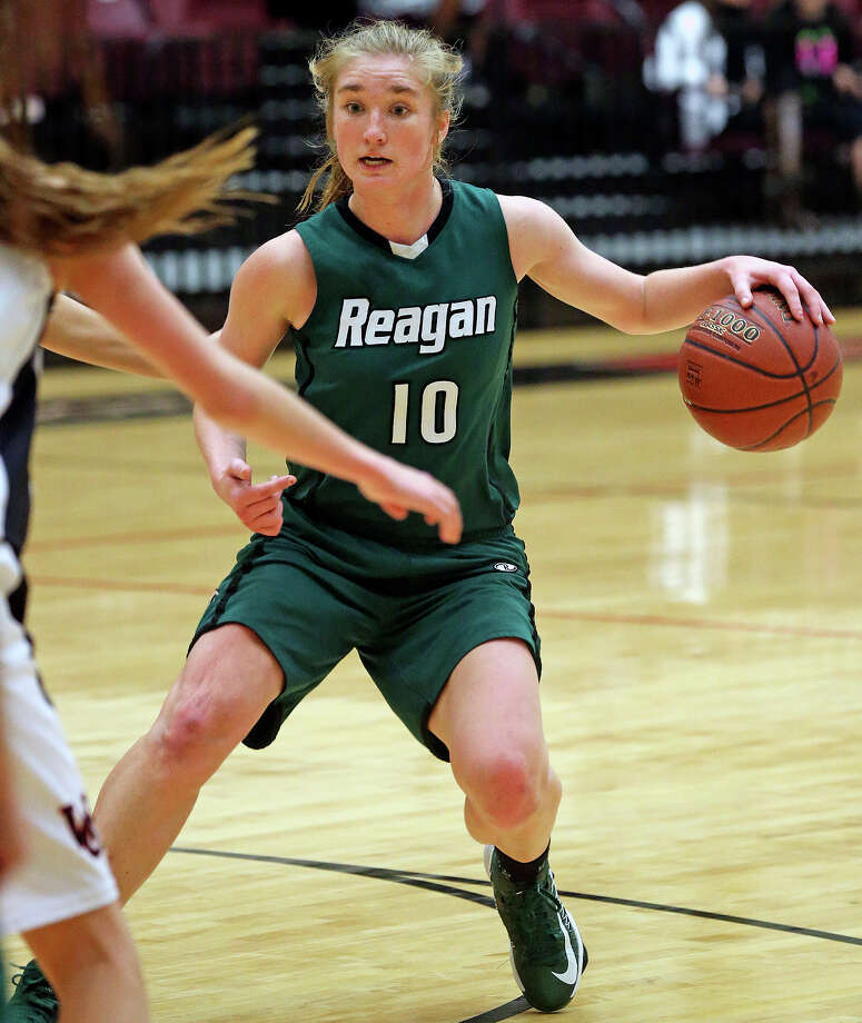 Wendy Knight runs the offense for the Rattlers as Reagan plays Churchill in girls basketball at Littleton Gym on January 14, 2014. Photo: TOM REEL