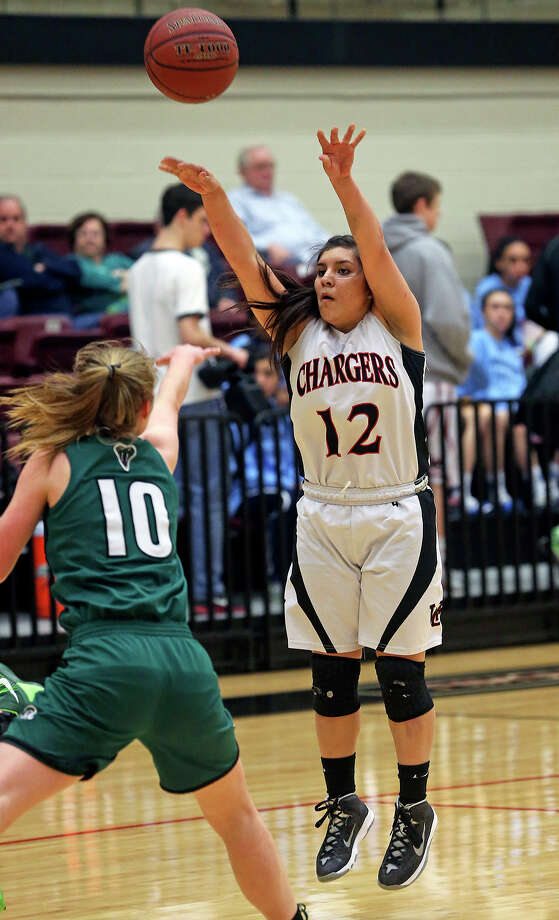 Mikki Flores pumps a long shot for the Chargers as Reagan plays Churchill in girls basketball at Littleton Gym on January 14, 2014. Photo: TOM REEL