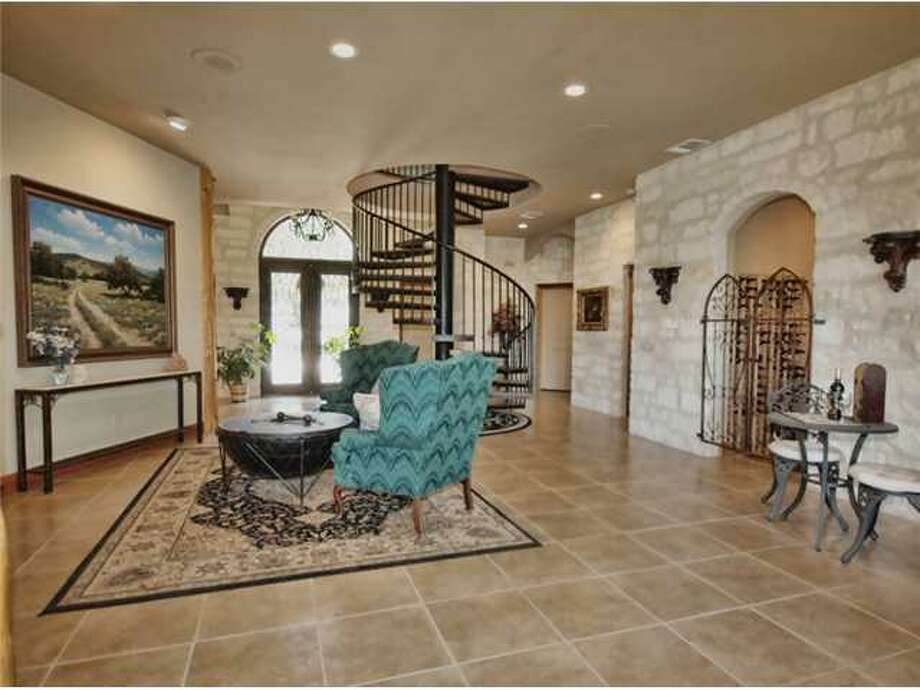 This Alamo replica home in Spicewood, north of Austin, is on the market listed at $1.35 million. Photo: Estately