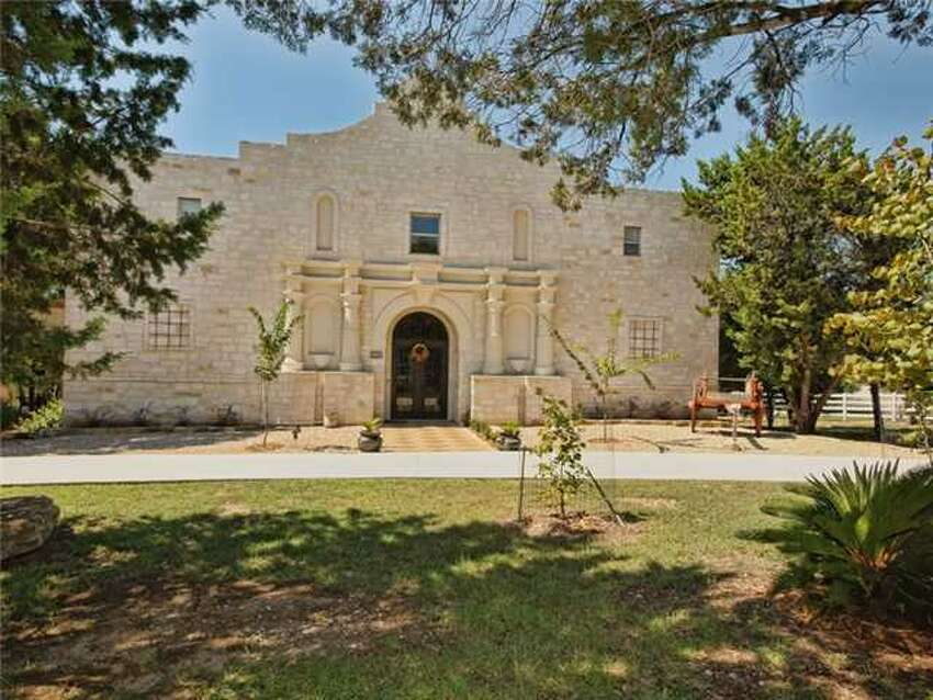 This is a house for those with true 'Texas spirit.' Modeled about the historic Alamo and located at 500 Contrails Way, Spicewood, TX 78669, this house boasts a waterfront view with its own dock. Rustic on the outside, it's far more luxurious on the inside than the real Alamo. The 6,553-square-foot home boasts four bedrooms, five bathrooms, a home theater and beautiful views from the second story porch - a better view than Rivercenter mall for sure. Need more info? The MLS# is 9996407.