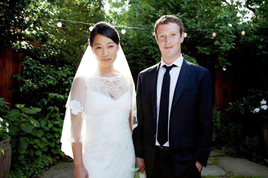 "Mark Zuckerberg & Priscilla Chan: ""Last Night on Earth"" by Green Day Photo: AP"