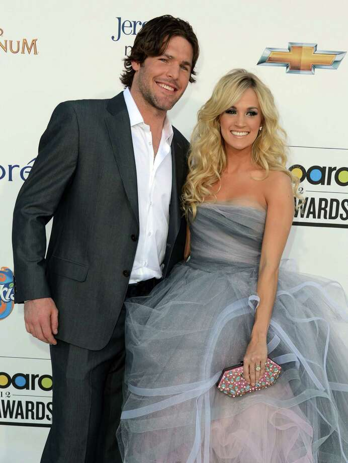 "Carrie Underwood & Mike Fisher: ""Love Never Fails"" by Brandon Heath Photo: Frazer Harrison, Getty Images For ABC / 2012 Getty Images"