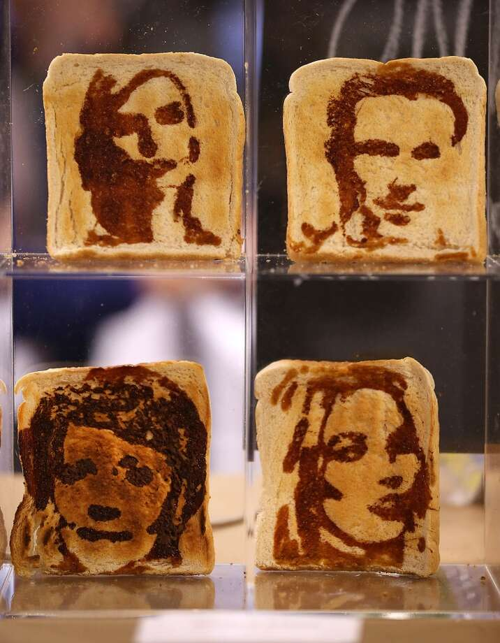 Marmite spread painted toast portraits are displayed at the Experimental Food Society Exhibition on Nov. 8, 2013 in London, England. A collective of  food magicians, sonic food artists, cake sculptors, gastronomic tailors, culinary cabaret troupes and a dining conceptualist gathered together for a two day exhibition featuring their unique edible creations. Photo: Peter Macdiarmid, Getty Images