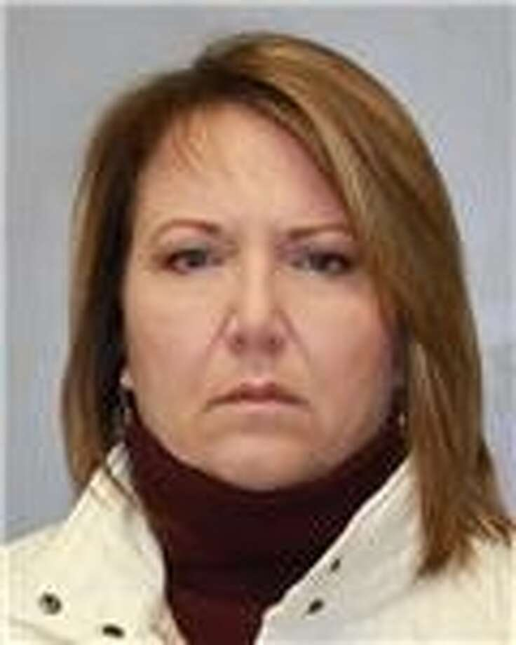 Theresa Carter, 51, of Amsterdam is accused of stealing more than  $50,000 from her employer. (State Police photo)
