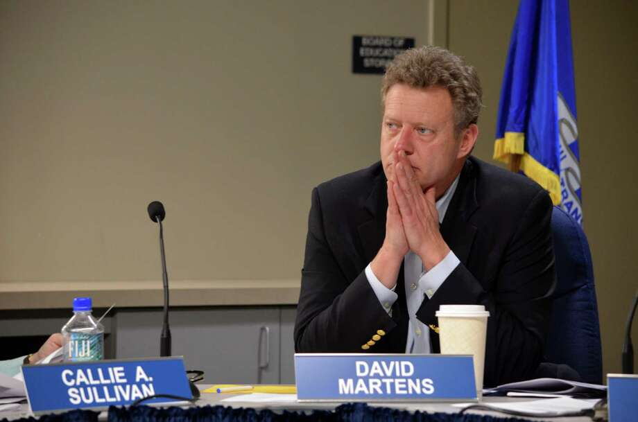 Board mmember David Martens listens during budget discussion at the Tuesday, Jan. 14 Board of Education meeting in Darien, Conn. Photo: Megan Spicer / Darien News