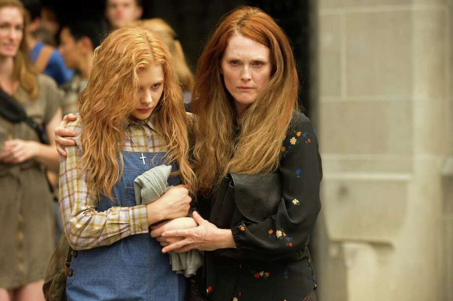 "This photo released by Sony Pictures shows Chloe Moretz, left, and Julianne Moore in a scene from the horror film ""Carrie."" (AP Photo/Sony Pictures, Michael Gibson) ORG XMIT: NYET611 Photo: Michael Gibson / Sony Pictures"
