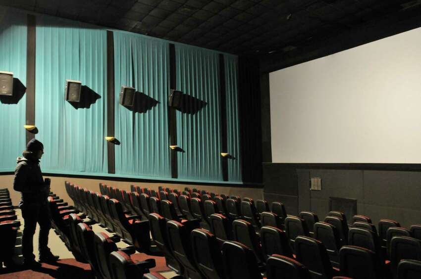 Cosmic Cinemas, a company that runs dinner theaters with high-end food and alcohol, will take over Albany's Madison Theater from Tierra Farm in a deal that should be finalized by the end of the month.