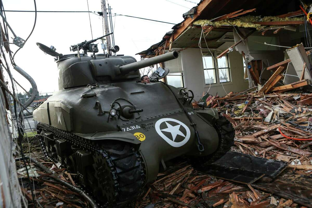 Jason Muszala uses a restored M4A1 Sherman Tank to to knock down part of a building being demolished for a new