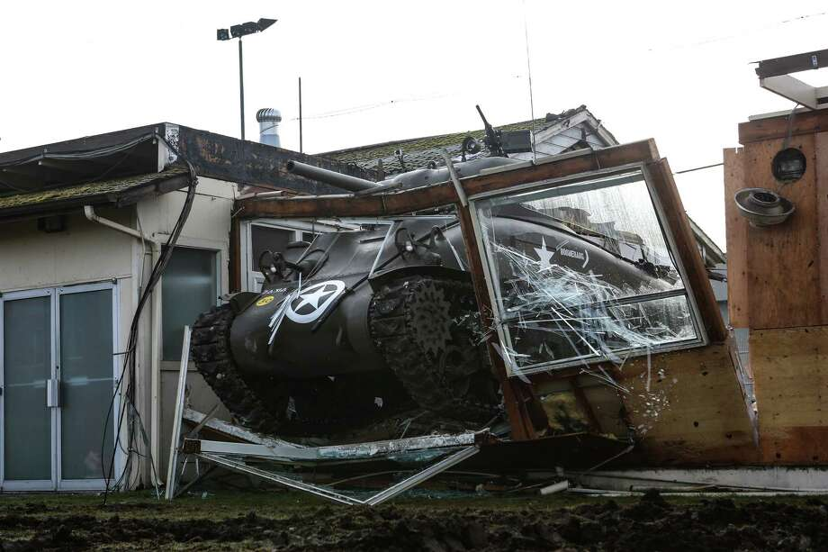 "A restored M4A1 Sherman Tank is used to knock down part of a building being demolished for a new ""Tank Arena"" at Paul Allen's Flying Heritage Collection at Paine Field in Everett on Wednesday, January 15, 2014. The Tank Arena will be a space where the collection's tracked vehicles and tanks can be operated during demonstrations. Photo: JOSHUA TRUJILLO, SEATTLEPI.COM / SEATTLEPI.COM"