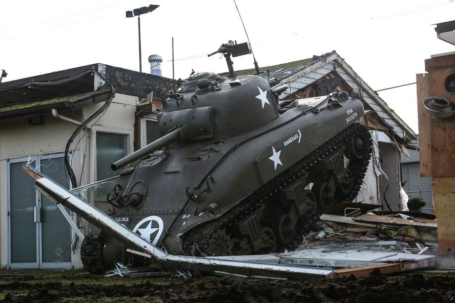 """A restored M4A1 Sherman Tank is used to knock down part of a building being demolished for a new """"Tank Arena"""" at Paul Allen's Flying Heritage Collection at Paine Field in Everett on Wednesday, January 15, 2014. The Tank Arena will be a space where the collection's tracked vehicles and tanks can be operated during demonstrations. Photo: JOSHUA TRUJILLO, SEATTLEPI.COM / SEATTLEPI.COM"""