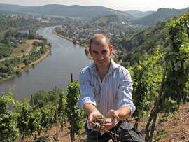Winemaker Florian Lauer in his vineyards near the town of Ayl, in the Saar Valley, whose river is a a tributary of Germany's Mosel. Lauer makes a range of Rieslings that are neither distinctly dry nor sweet. OLYMPUS DIGITAL CAMERA