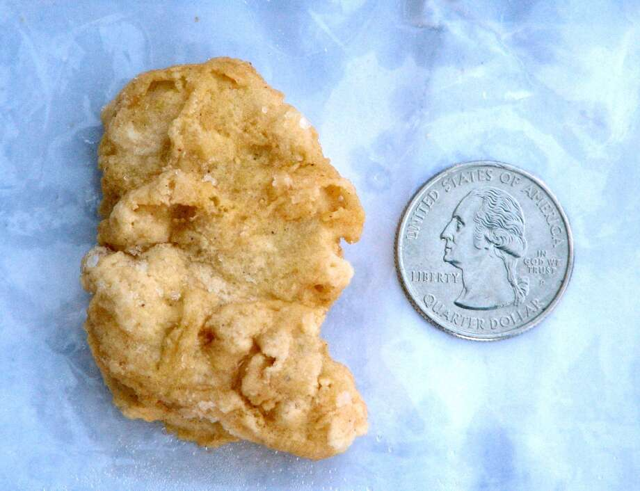 A McDonald's Chicken McNugget found by Rebekah Speight of Dakota City, which she believes resembles President George Washington is placed next to a U.S. quarter dollar bearing the image of the president. Speight sold the three-year-old nugget for $8,100 on eBay. Photo: Nate Robson, Associated Press