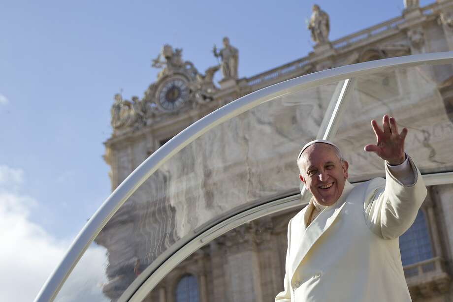Pope Francis waves from his pope-mobile at the end of his weekly general audience, in St. Peter's Square, at the Vatican, Wednesday, Jan. 15, 2014. (AP Photo/Andrew Medichini) Photo: Andrew Medichini, Associated Press