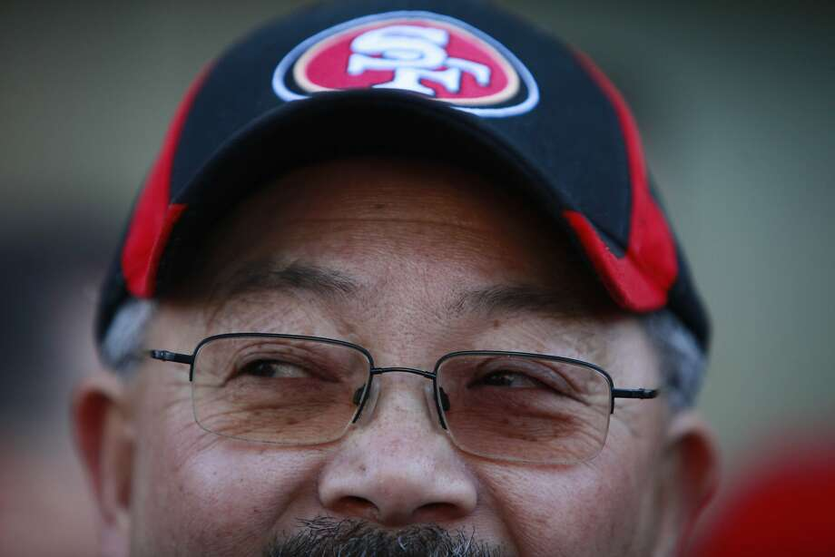 Mayor Ed Lee wears a 49er cap as he arrives at the Gold Dust Lounge, at it's new Fisherman's Wharf location,  before the start of the Super Bowl on Sunday, February 3, 2013 in San Francisco, Calif. Photo: Lea Suzuki, The Chronicle