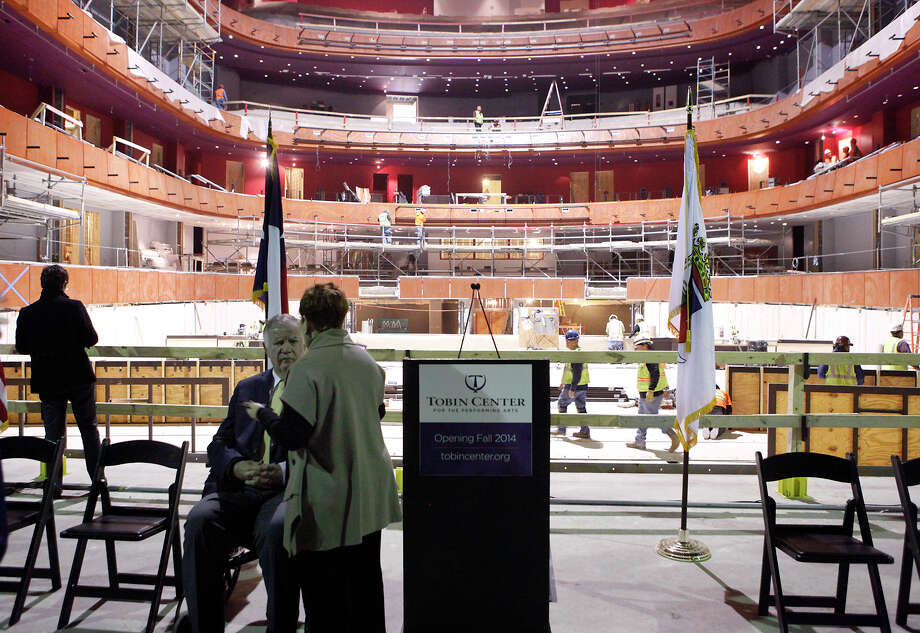 Lowry Mays speaks with Diane Warren inside the Tobin Center for the Performing Arts before the start of a program  Wednesday, Jan. 15, 2014 announcing the Tobin Wall of Memories, where people are being asked to send photos and their memories from events at the Municipal Auditorium and the announcement of a gift of $1,250,000 to the Capital Campaign from Mays Family Foundation. The original faade and foyer Ð the Òfront doorÓ of the original Municipal Auditorium which will also become the front door for The Tobin Ð will henceforth be known as the ÒMays Family Historic Faade and Foyer.Ó The Tobin Center is set to open in September 2014. Photo: Cynthia Esparza, For The San Antonio Express-News / For San Antonio Express-News