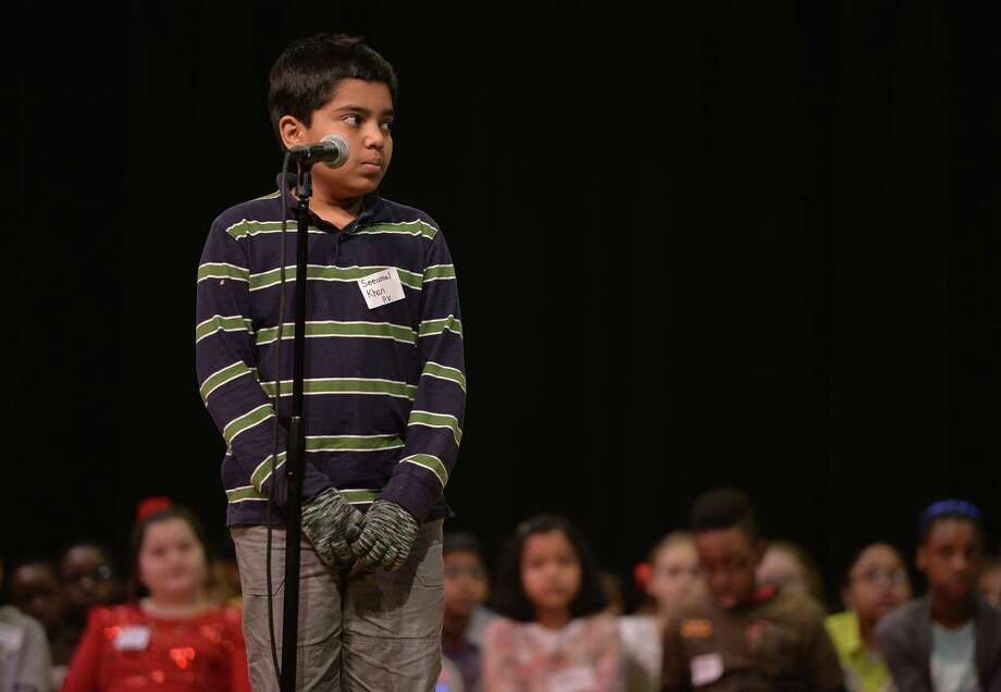 Seeamul Khan looks for guidance from the judges during the Schenectady City School District Elementary Spelling Bee Wednesday morning, Jan. 15, 2014, at Schenectady High School in Schenectady, N.Y. (Skip Dickstein / Times Union) Photo: Skip Dickstein / 00025369A