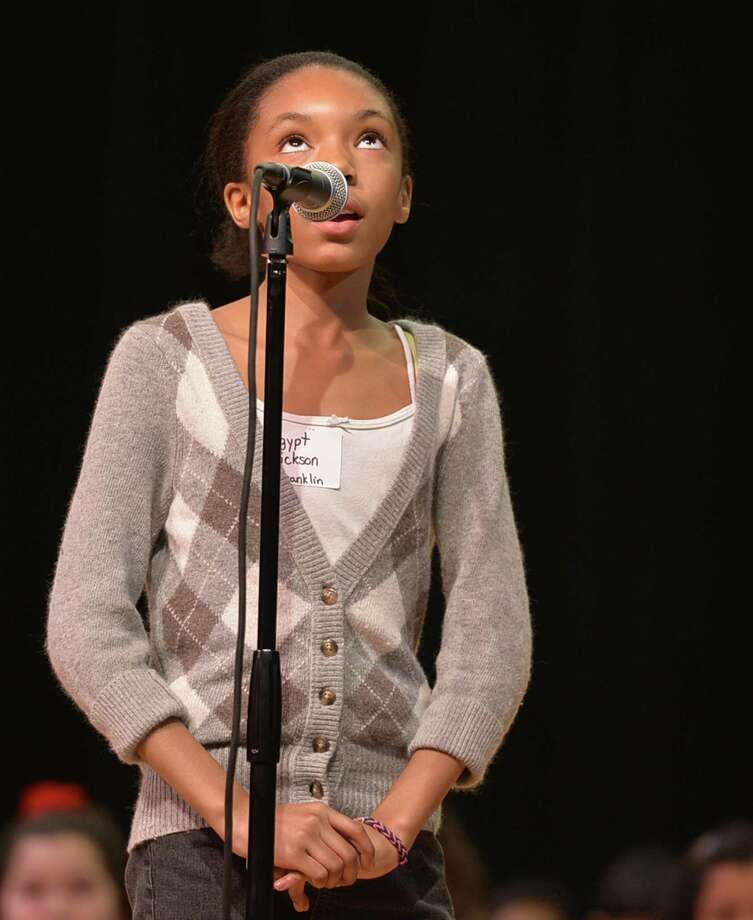 Egypt Hickson looks to the skies for the spelling of a word during the Schenectady City School District Elementary Spelling Bee Wednesday morning, Jan. 15, 2014, at Schenectady High School in Schenectady, N.Y. (Skip Dickstein / Times Union) Photo: Skip Dickstein / 00025369A