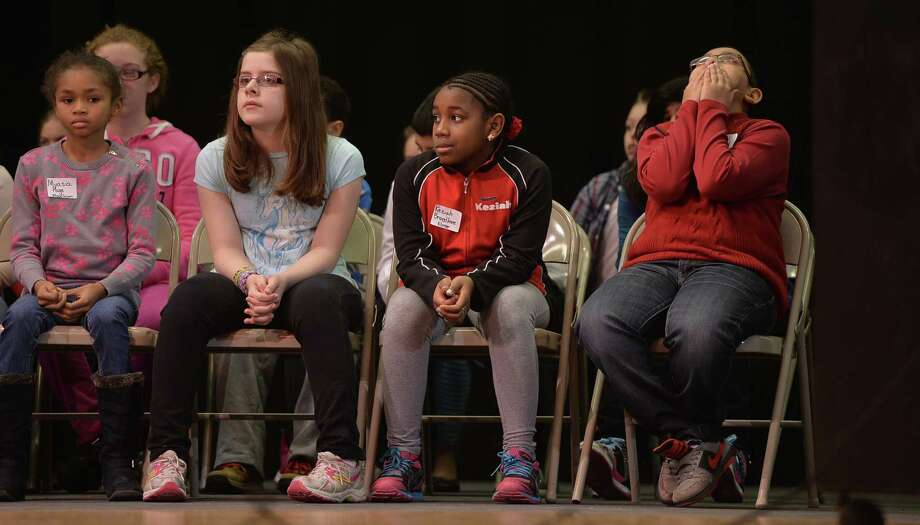 Jerry Persaud Jr. of Elmer Avenue school, right, stifles a yawn during the Schenectady City School District Elementary Spelling Bee Wednesday morning, Jan. 15, 2014, at Schenectady High School in Schenectady, N.Y.    (Skip Dickstein / Times Union) Photo: Skip Dickstein / 00025369A