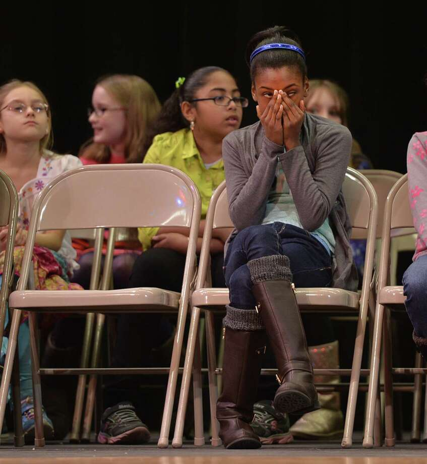 Niyah Hope-Glenn of Woodlawn Elementary School reacts to a contestant's incorrect spelling of a word during the Schenectady City School District Elementary Spelling Bee Wednesday morning, Jan. 15, 2014, at Schenectady High School in Schenectady, N.Y. (Skip Dickstein / Times Union) Photo: Skip Dickstein / 00025369A