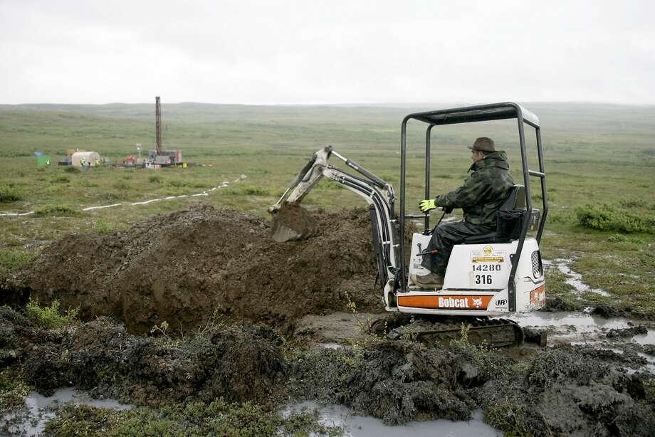 A worker test-drills in Alaska's Bristol Bay region, home to much of the world's wild sockeye salmon. Photo: AL Grillo, Associated Press