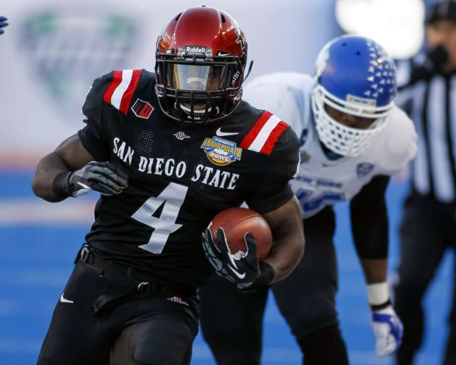 Adam Muema  Position: Running back  School: San Diego State Photo: Otto Kitsinger, Associated Press