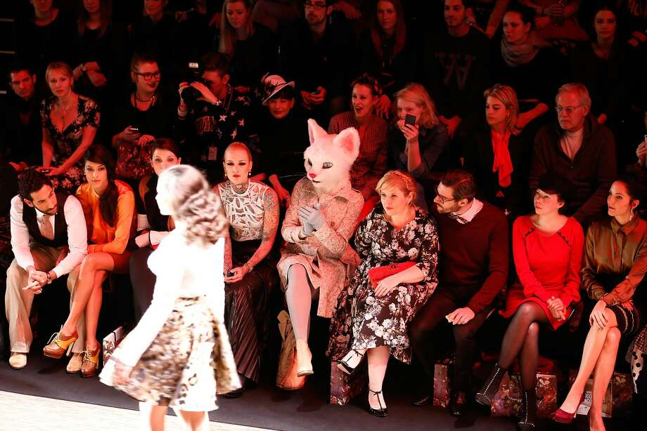 A cat in the audiencewatches a human on the catwalk during the Rebekka Ruetz show at Mercedes-Benz Fashion Week in Berlin. Photo: Andreas Rentz, Getty Images For IMG