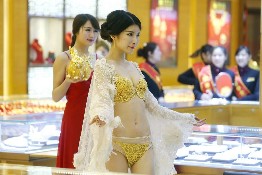 All that glitters is under her clothes: Even Victoria's Secret models don't get to wear lingerie like this - a bra and panties made from about $827,000 worth of gold at a jeweler's in Wuhan, China. In addition to the precious-metal undies, the shop also crafted a gold rabbit (held by the model in red) with plenty of carats. Photo: Stringer, AFP/Getty Images