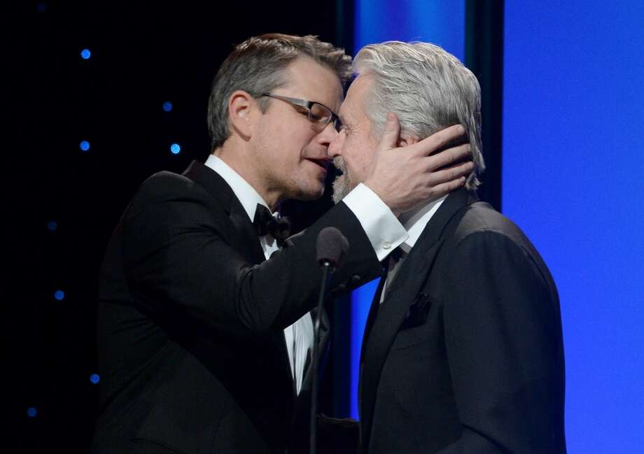 United Nations Messenger of Peace Michael Douglas (R) accepts the Danny Kaye Humanitarian Peace Award onstage from Matt Damon during the 2014 UNICEF Ball presented by Baccarat at the Beverly Wilshire Four Seasons Hotel on January 14, 2014 in Beverly Hills, California. Photo: Michael Buckner, Getty Images For UNICEF