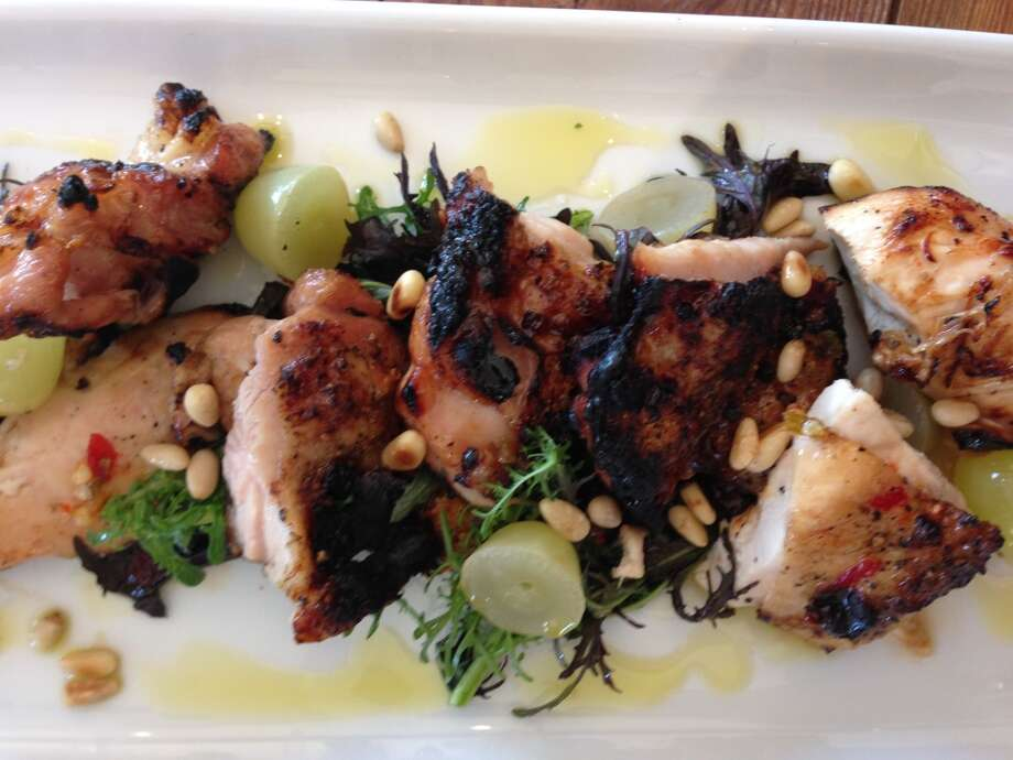 Wood-grilled chicken, pine nuts and pickled grapes with agrodolce at Coltivare. (Photo: Greg Morago)