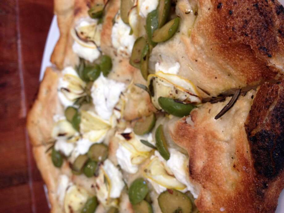A pizza with Meyer lemon, olives, goat cheese and rosemary at Coltivare. (Photo: Greg Morago)