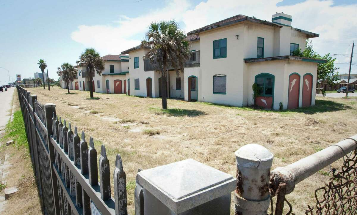 One of the former Fort Crockett officers quarters, Wednesday, Aug. 8, 2012, in Galveston. The nine buildings were sold to a private company in 2000. The attorney general is suing the owner on behalf of the Texas Historical Commission for failing to fulfill a clause in the sale contract requiring that the buildings be preserved. The commission obtained a restraining order last year preventing the owner from demolishing the buildings and case is stalled in court. A trial is not scheduled until April next year. Meanwhile the buildings are deteriorating and an inspection done for the owner suggests that they need to be torn down.