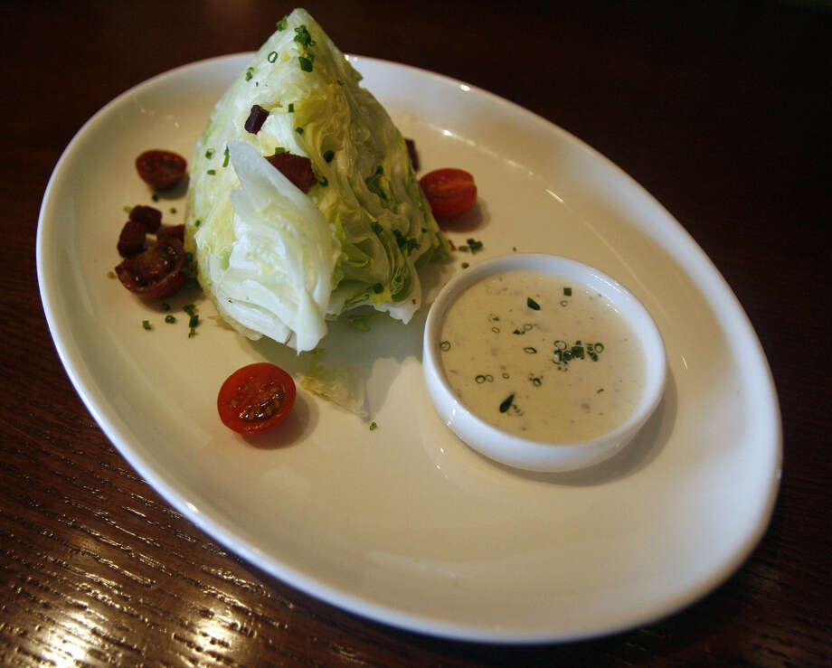 The wedge salad is served with a housemade ranch dressing at the 18 Oaks Restaurant in the JW Marriott San Antonio Hill Country Resort & Spa. Photo: Express-News File Photo / SAN ANTONIO EXPRESS-NEWS