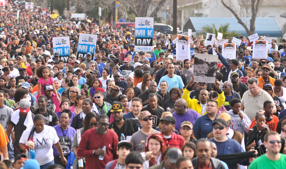 Thousands of people walk along Martin Luther King Drive during last year's MLK March. Photo: Express-News File Photo