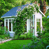 garden cottage greenhouse owner connie featherston overwinters her orchids and raises heirloom vegetable seedlings in this - Garden Sheds Exeter