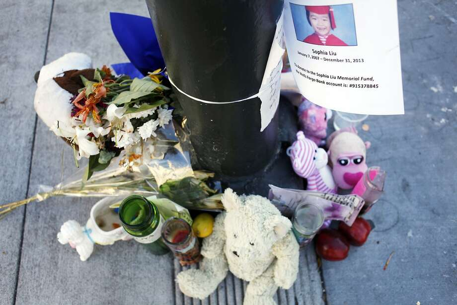 Mourners have created a makeshift memorial for Sophia Liu at the corner of Polk and Ellis streets on January 15, 2014 in San Francisco, Calif. Sophia Liu, 6, was killed, and two people were injured at the intersection on New Year's Eve.  Photo: Pete Kiehart, The Chronicle