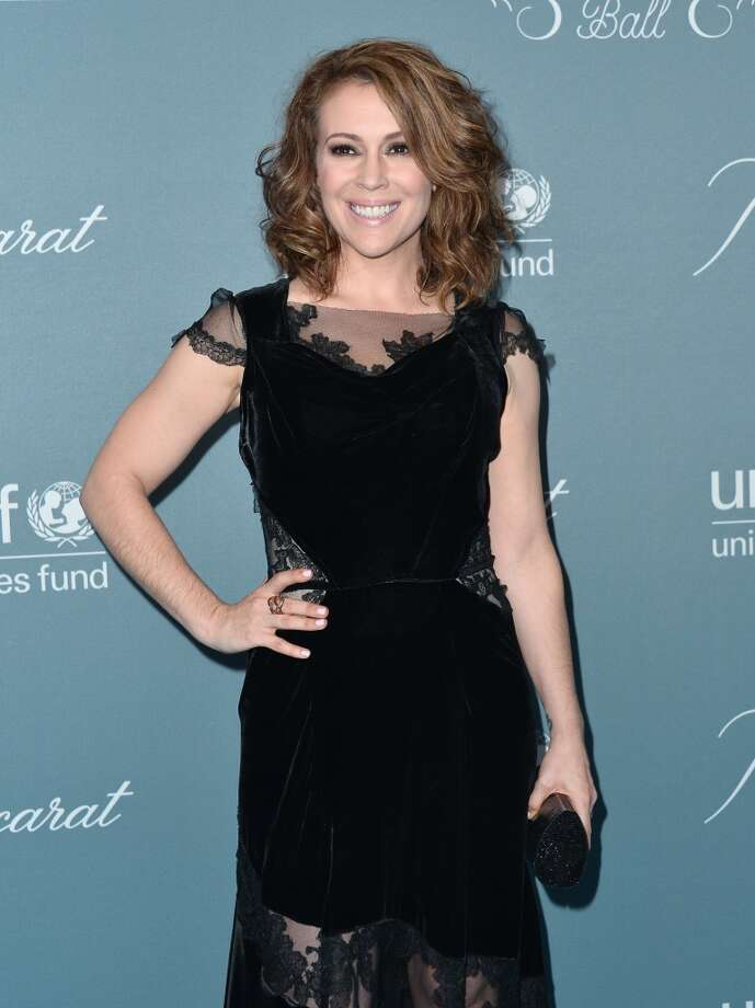 Actress Alyssa Milano arrives to the 2014 UNICEF Ball Presented by Baccarat at the Regent Beverly Wilshire Hotel on January 14, 2014 in Beverly Hills, California. Photo: Alberto E. Rodriguez, Getty Images