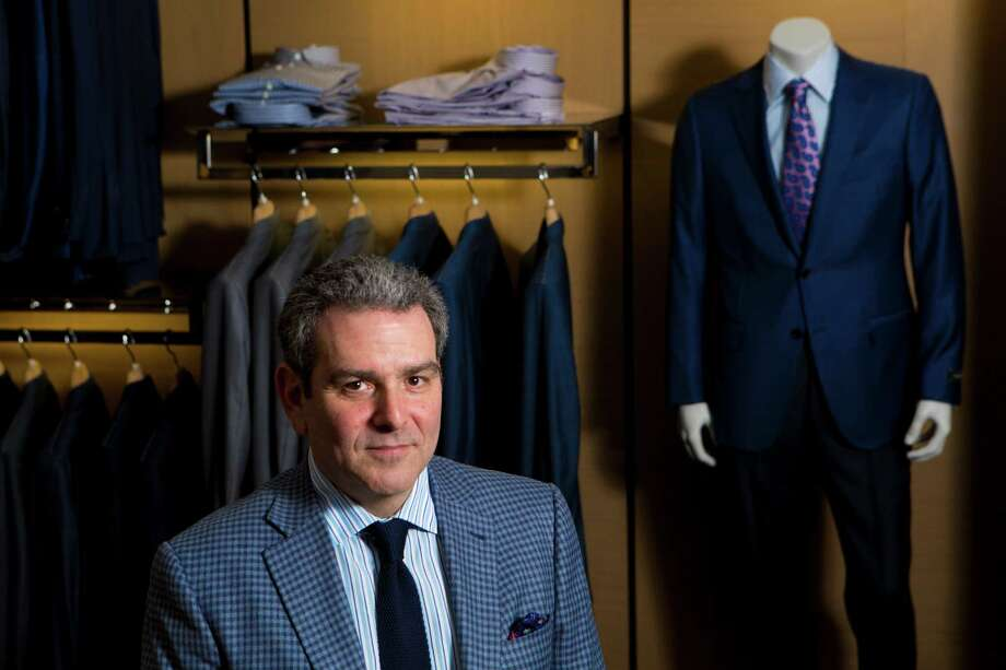 Left: Murry Penner's clothing store M Penner celebrates its 40th anniversary this year. it was founded by his father, Morris Penner. Below:   Tailor Javier Aceves trims fabric. Aceves has worked at M Penner for nearly 30 years. Photo: Marie D. De Jesus, Staff / © 2014 Houston Chronicle