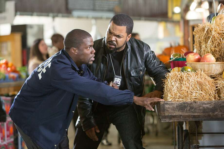 """Kevin Hart (left) and Ice Cube star in """"Ride Along,"""" a story about unusual police partners with a plot that might sound familiar to anyone who saw """"48 Hrs."""" in 1982 or """"Rush Hour"""" in 1998. Photo: Quantrell D. Colbert, Universal Pictures"""