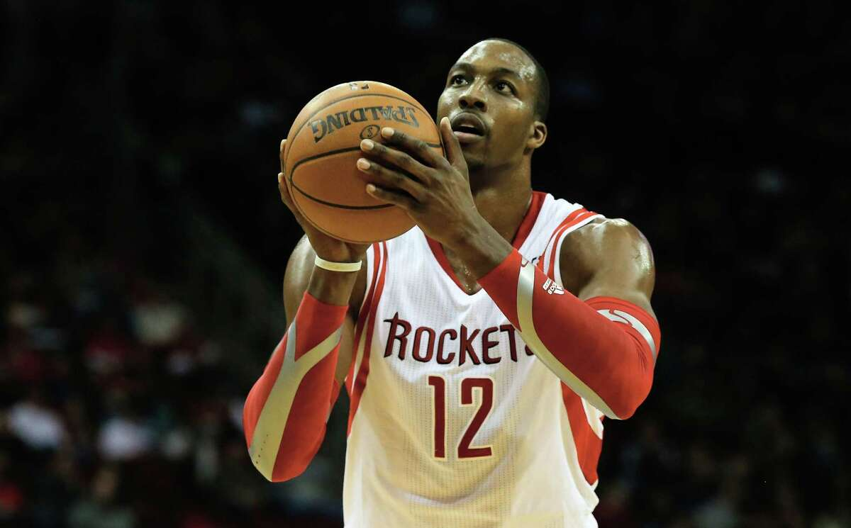 HOUSTON, TX - DECEMBER 08: Dwight Howard #12 of the Houston Rockets take a free throw during the game against the Orlando Magic at Toyota Center on December 8, 2013 in Houston, Texas. NOTE TO USER: User expressly acknowledges and agrees that, by downloading and or using this photograph, User is consenting to the terms and conditions of the Getty Images License Agreement. (Photo by Scott Halleran/Getty Images)