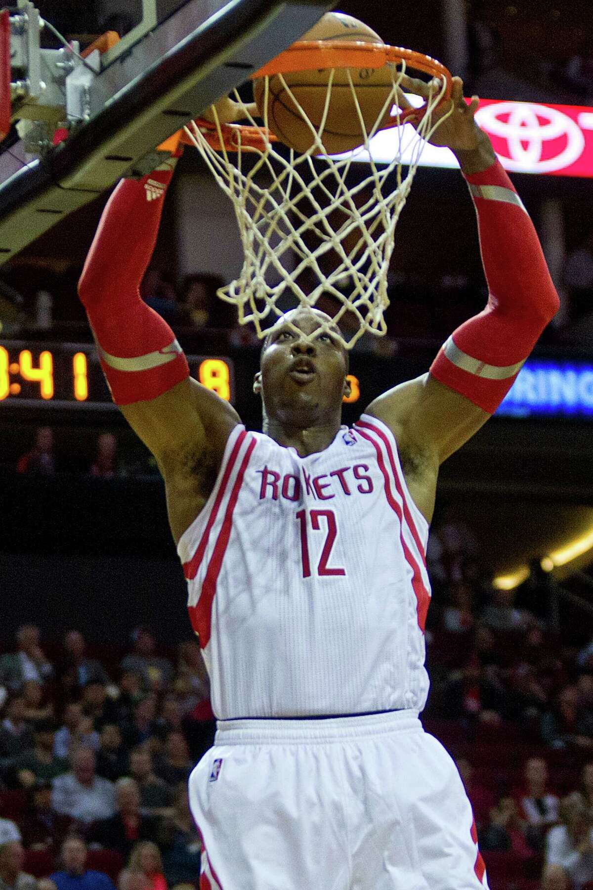 Houston Rockets power forward Dwight Howard (12) scores early on the game against the Chicago Bulls, Wednesday, Dec. 18, 2013, in Houston at the Toyota Center. Houston beat Chicago 109-94. ( Marie D. De Jesus / Houston Chronicle )