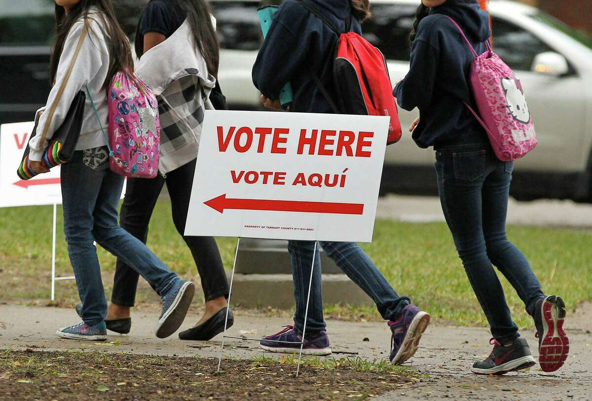 Students arrive at W.P. McClean 6th Grade Center in Fort Worth, Texas on Tuesday, Nov.5, 2013. Texas voters are casting ballots on several statewide proposals, including a $2 billion water plan, but not before they were legally required to show a photo ID at the polls for the first time. (AP Photo/The Fort Worth Star-Telegram, Ron T. Ennis) MAGS OUT; (FORT WORTH WEEKLY, 360 WEST); INTERNET OUT