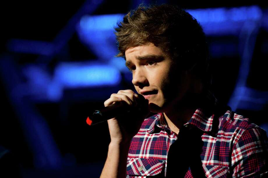 "FILE - This is a Saturday, May 26 2012 file photo of One Direction member Liam Payne as heperforms in concert, in New York.   Payne said Wednesday Jan. 15, 2014 that  he is sorry for being ""stupid and irresponsible""  after standing on the ledge of a high-rise with a city that appears to be London behind him.(AP Photo/Charles Sykes, File) ORG XMIT: LON103 Photo: Charles Sykes / AP"