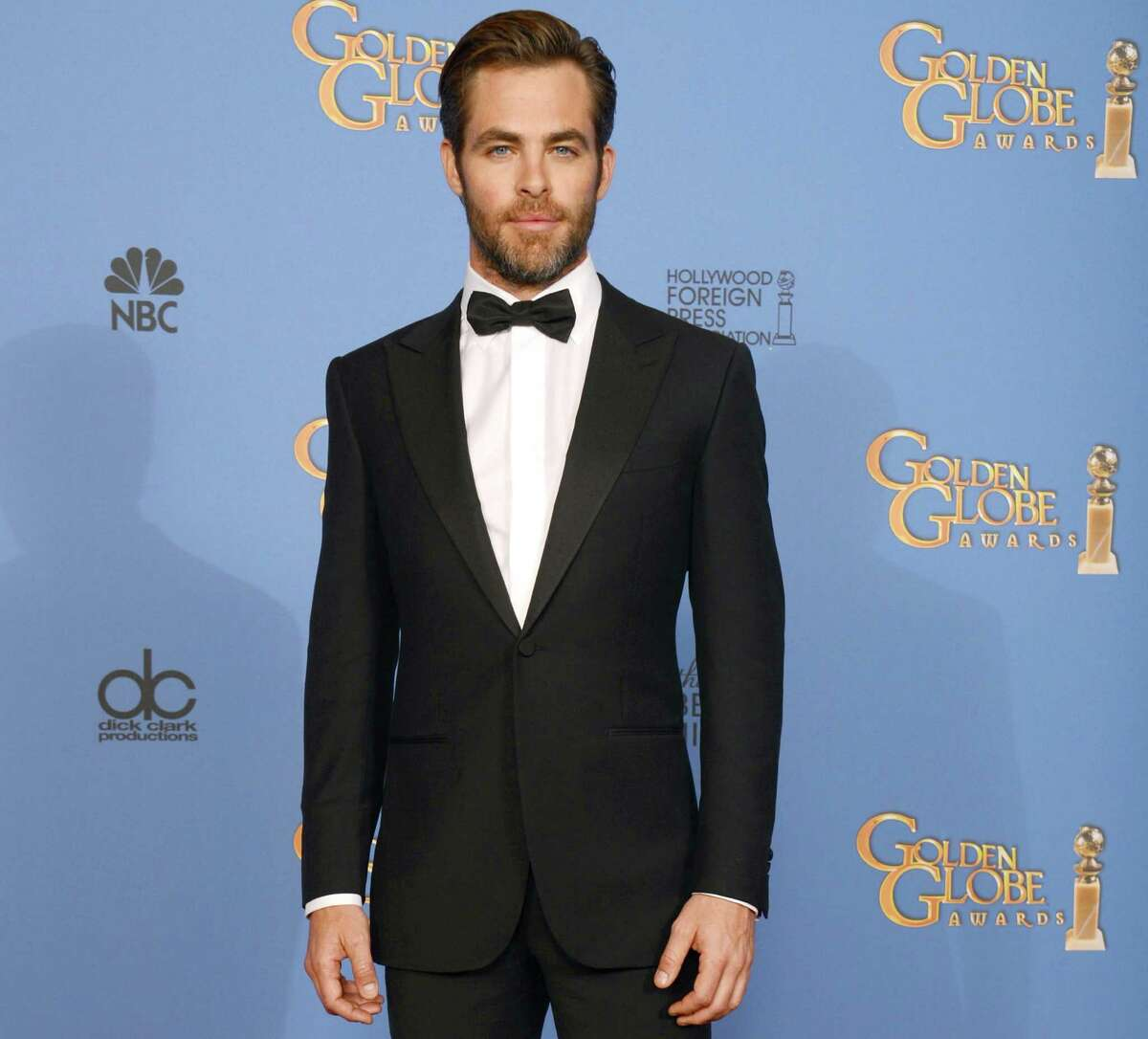 """FILE - In this Sunday, Jan. 12, 2014 file photo, actor Chris Pine poses in the press room at the 71st annual Golden Globe Awards at the Beverly Hilton Hotel, in Beverly Hills, Calif. Pine says the US should have done more in the run-up to the Olympics to protest Russia?'s anti-gay legislation, which he calls ?""""clearly awful, archaic, hostile nonsense.?"""" ?""""I think we should do more than just send gay Olympians there,?"""" he said in an interview while promoting his film ?""""Jack Ryan: Shadow Recruit,"""" which opens Friday, Jan. 17, 2014. (Photo by Jordan Strauss/Invision/AP) ORG XMIT: CAET732"""